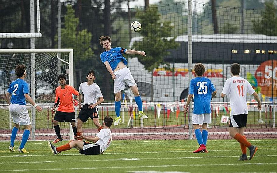 Marymount's Alexander Klarenbeek, center, heads the ball out during the DODEA-Europe Division II soccer championship in Kaiserslautern, Germany, on Thursday, May 24, 2018.