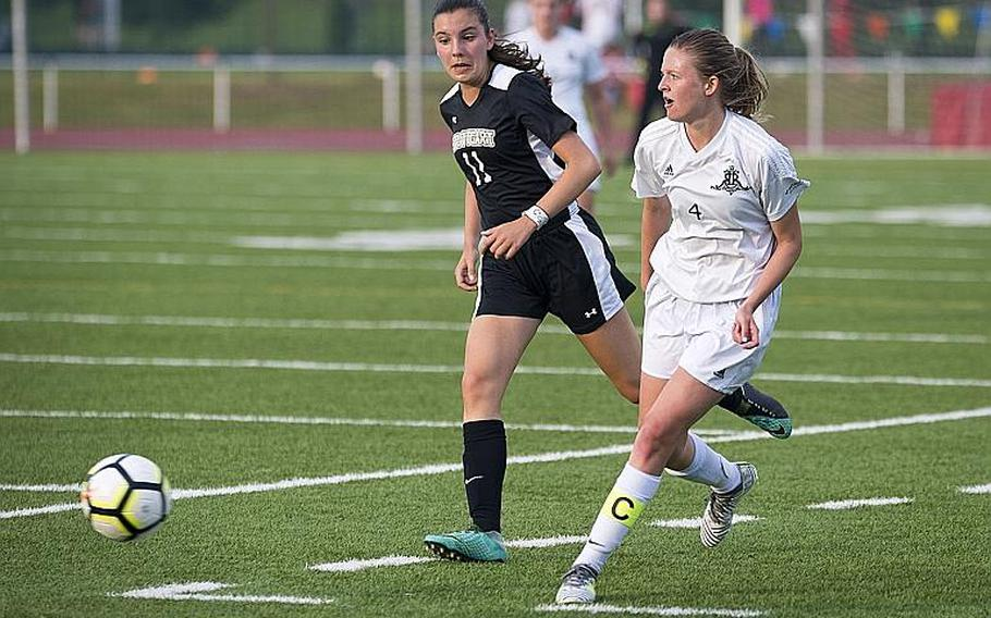 Ramstein's Brittany Cunningham, right, passes the ball in front of Stuttgart's Natalie Eddy during the DODEA-Europe Division I soccer championship in Kaiserslautern, Germany, on Thursday, May 24, 2018.