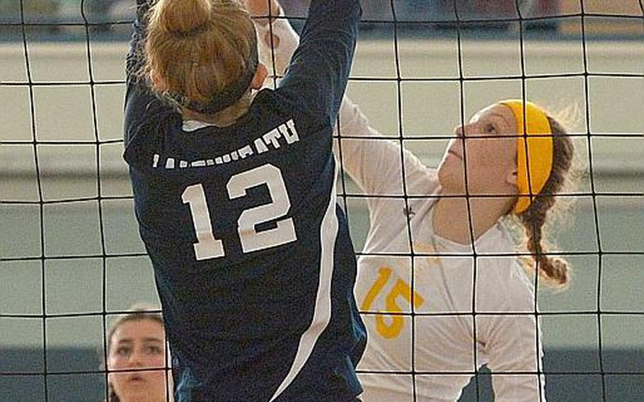 Stuttgart's Geneva Barriger gets the ball past the block by Lakenheath's Jayden Thormann in the Division I title game at the DODEA-Europe volleyball finals in Kaiserslautern, Germany, Saturday, Nov.4, 2017. Lakenheath defeated Stuttgart 25-23, 25-23, 25-20.