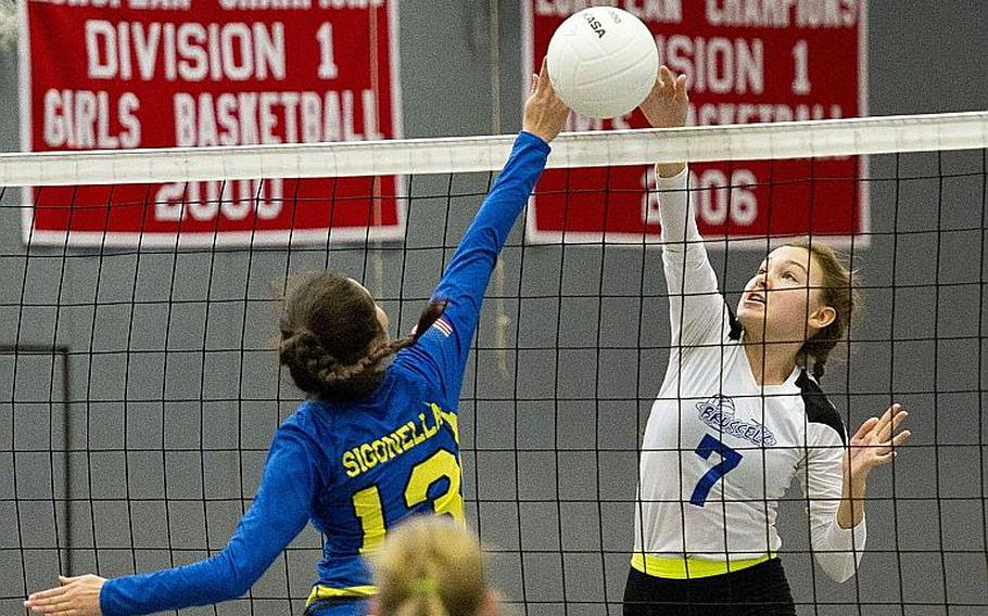 Brussels' Jewels Friedhoff, right, and Sigonella's Kristiana Wyrick battle for the ball at the net during the DODEA-Europe semifinals at Vogelweh, Germany, on Friday, Nov. 3, 2017.