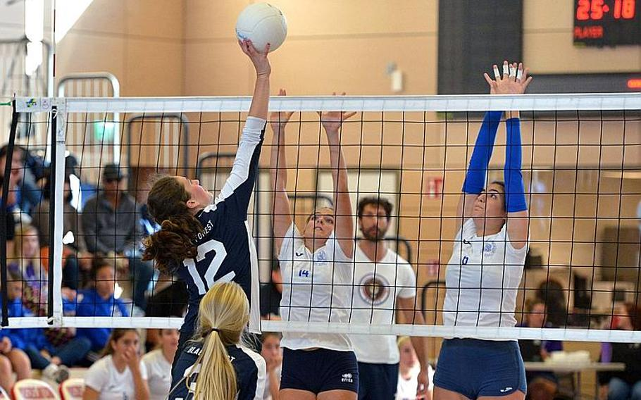 Black Forest Academy's Brianne Maier hits one over the net against the Marymount block of Margherita Guerra, left, and Sofia Daniele in the Division II final at the DODEA-Europe volleyball championships in Kaiserslautern. Marymount took the title with a 24-26, 25-18, 25-21, 25-13 win.