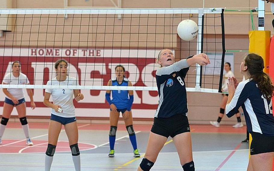 Black Forest Academy's Liz McKell hits the ball back over the net as teammate Brianne Maier watches. Marymount took the Division II DODEA-Europe volleyball title with a 24-26, 25-18, 25-21, 25-13 win over BFA.