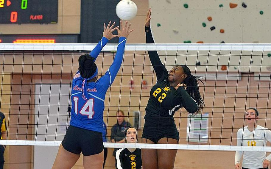 Ramstein's Shemilia Johnson and Stuttgart's Skye DeSilva Mathis battle at the net in the Division I final at the DODEA-Europe volleyball championships in Kaiserslautern, Germany. Stuttgart took the title with a 25-23, 25-18, 25-10 win over the Royals.