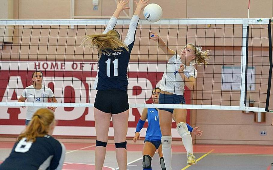 Black Forest Academy's Brooke Israel attempts to block a shot by Marymount's Luna Gulino in the Division II final at the DODEA-Europe volleyball championships in Kaiserslautern, Germany. Marymount took the title with a 24-26, 25-18, 25-21, 25-13 win.