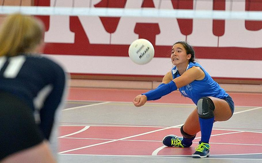 Marymount's Arianna Riviere digs deep to reach a Black Forest Academy serve in the Division II championship match at the DODEA-Europe volleyball finals. Marymount took the title with a 24-26, 25-18, 25-21, 25-13 win.