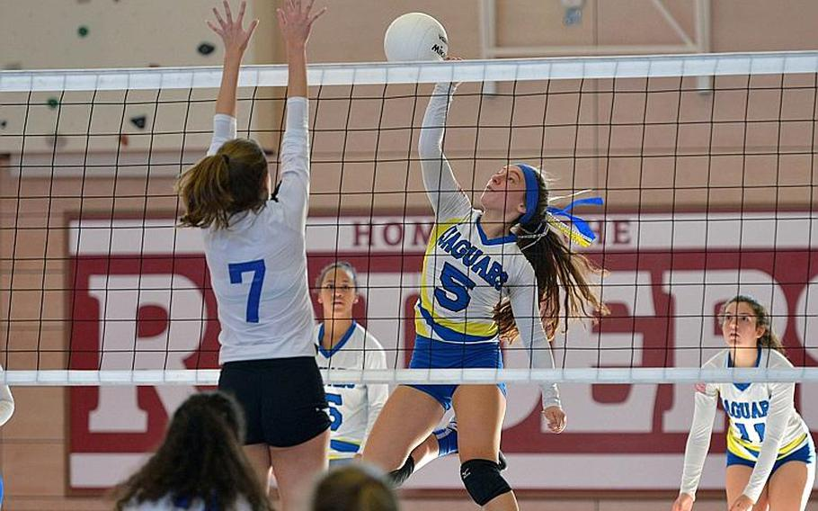 Sigonella's Jessica Jacobs hits the ball against Jewels Friedhoff of Brussels in the Division III final of the DODEA-Europe volleyball championships in Kaiserslautern, Germany, Saturday, Nov. 3, 2018. Sigonella took the title with a 25-14, 25-13, 23-25, 25-17 win and Jacobs was named the division MVP.