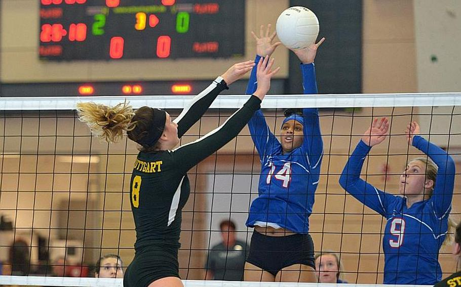 Stuttgart's Carly Sharp gets the ball love the net past Ramstein's Shemilia Johnson, left, and Paige Nielsen in the Division I final at the DODEA-Europe volleyball championships in Kaiserslautern, Germany. Stuttgart won  25-23, 25-18, 25-10.
