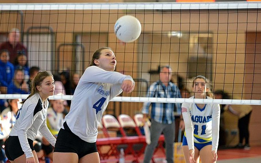 Olivia Friedhoff of Brussels returns a ball as Sigonella's Alex Garcia guards across the net in the Division III final of the DODEA-Europe volleyball championships in Kaiserslautern, Germany, Saturday, Nov. 3, 2018. Sigonella took the title with a 25-14, 25-13, 23-25, 25-17