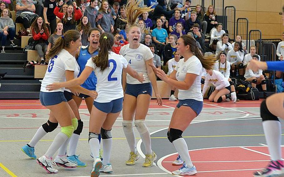 Marymount players celebrate their 24-26, 25-18, 25-21, 25-13 win over Black Forest Academy at the DODEA-Europe volleyball championships in Kaiserslautern, Germany, Saturday, Nov. 3, 2018.