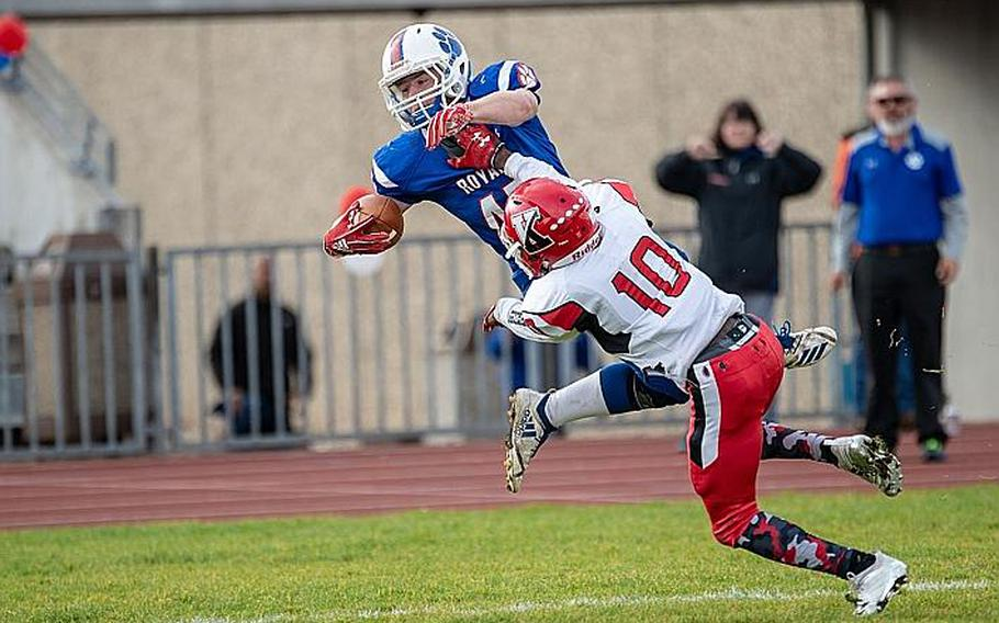 Bailey Holland is forced out of bounds by Cedric Ellis during the Ramstein vs Kaiserslautern football game at Ramstein, Germany, Saturday, Oct. 27, 2018.  Brian Ferguson/Stars and Stripes