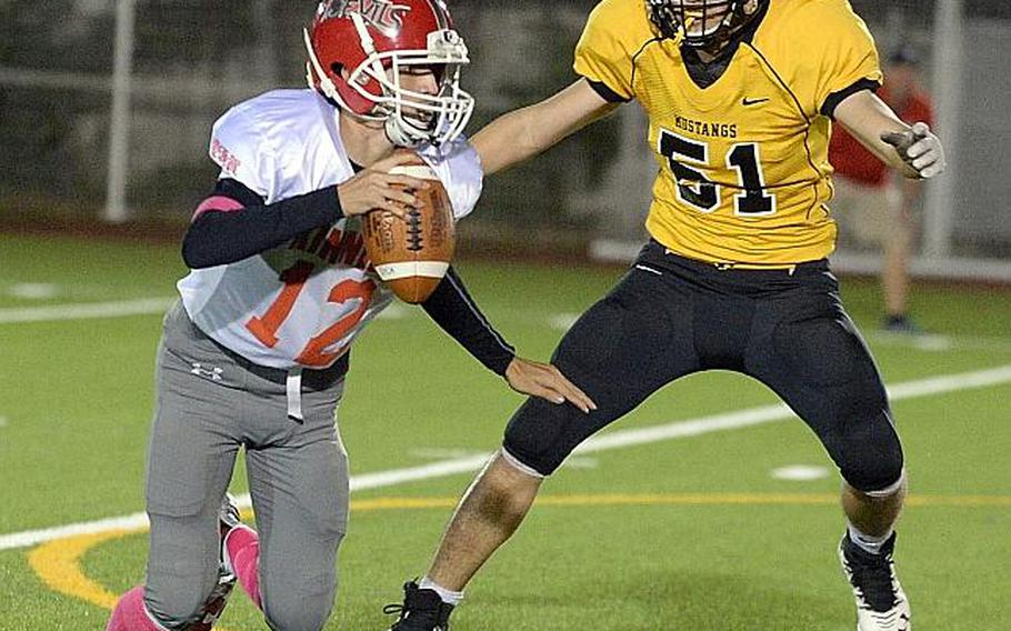 Nile C. Kinnick quarterback Patrick Kelly took the reins of the Red Devils offense this season after being the understudy for two years and led Kinnick to its first DODEA Pacific Far East Division I football title.