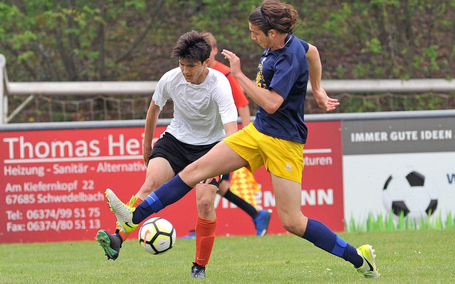 AFNORTH's James Barata centers the ball against Florence's Damiano Pacchiani in a Division II semifinal at the DODEA-Europe soccer finals in Reichenbach, Germany, Wednesday, May 23, 2018.