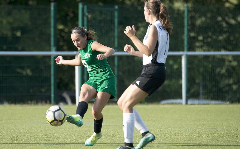 Naples' Abigail Houseworth, left, passes the ball around Stuttgart's Trinity Leahy during the DODEA-Europe soccer championships in Reichenbach, Germany, on Wednesday, May 23, 2018.