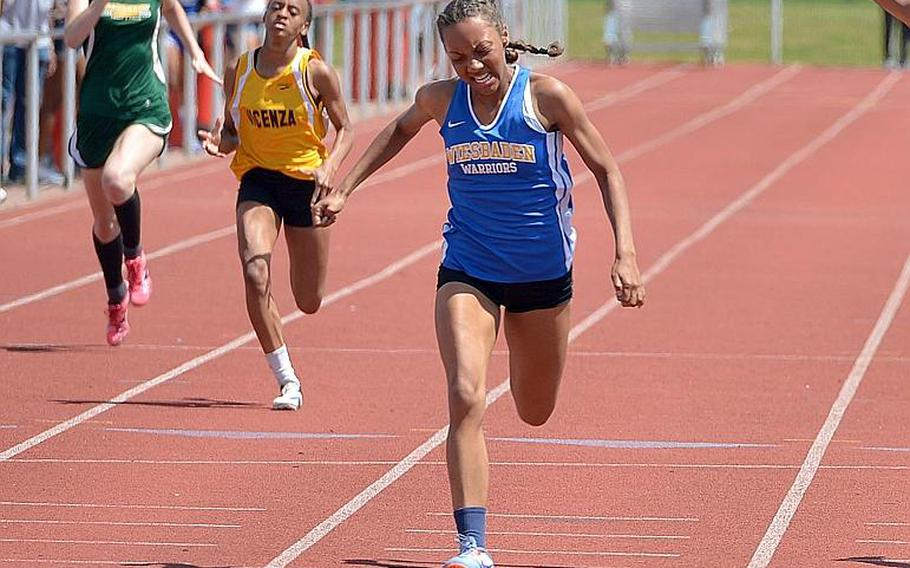 Wiesbaden's Whitney Bivins sprints to the finish line in the girls 200-meter race at the2018 DODEA-Europe track and field championships.