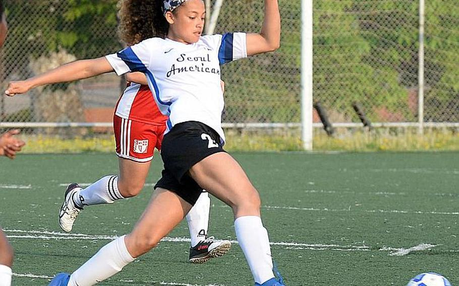 Seoul American's Mya Rolison gets set to boot the ball against Seoul Foreign during Wednesday's Korea girls soccer match. The Crusaders won 4-1 and clinched the Korea Blue regular-season championship.
