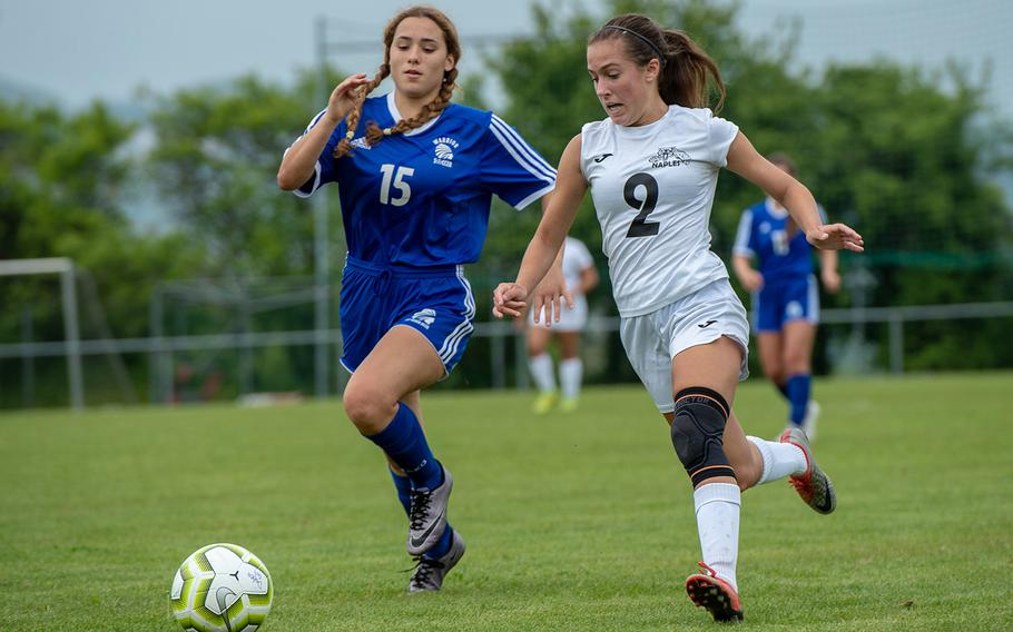 Naples' Abigail Houseworth, right, and Wiesbaden's Livia Baker-McKee chase down the ball during the first day of the DODEA-Europe soccer championships, Monday, May 20, 2019.