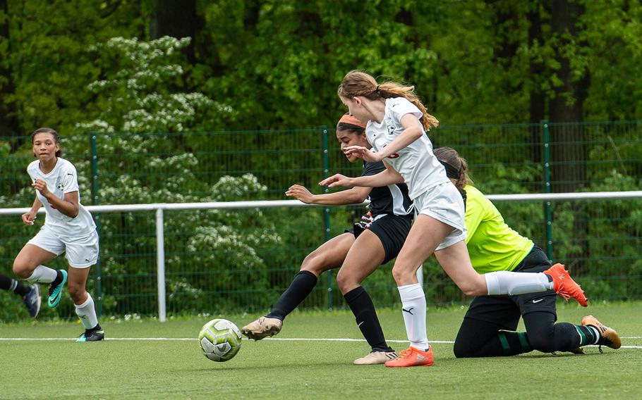 Stuttgart's Bettina Wagner shoots and scores during a game against Kaiserslautern on the first day of the DODEA-Europe soccer championships, Monday, May 20, 2019.
