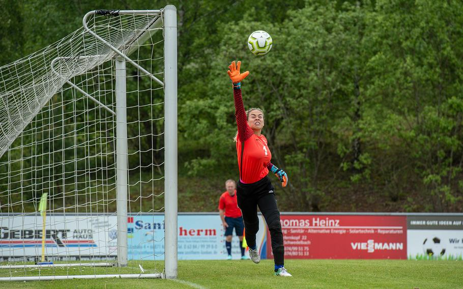Wiesbaden goalkeeper Karli Wallace reaches for the ball during a game against Naples on the first day of the DODEA-Europe soccer championships, Monday, May 20, 2019.