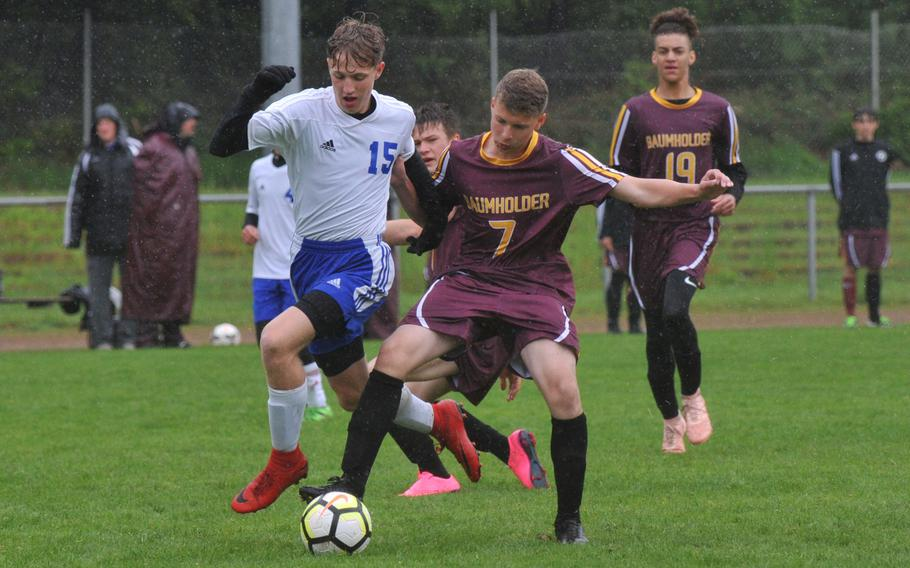 Dennis Yusofoff of Hohenfels gets past Baumholder defender Noel King on his way to scoring a goal in the Tigers' 7-0 win over the Bucs in a Division III game in Landstuhl, Tuesday, May 21, 2019.