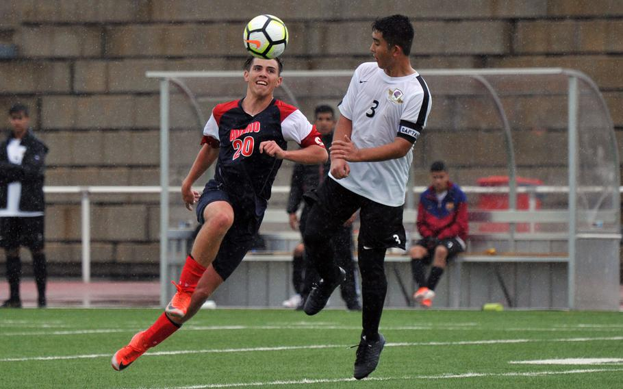 Aviano's Logan Hinchcliff knees the ball over Bahrain defender Joseph Camuso in a Division II game in Kaiserslautern, Tuesday, May 21, 2019. The game ended in a 1-1 tie.