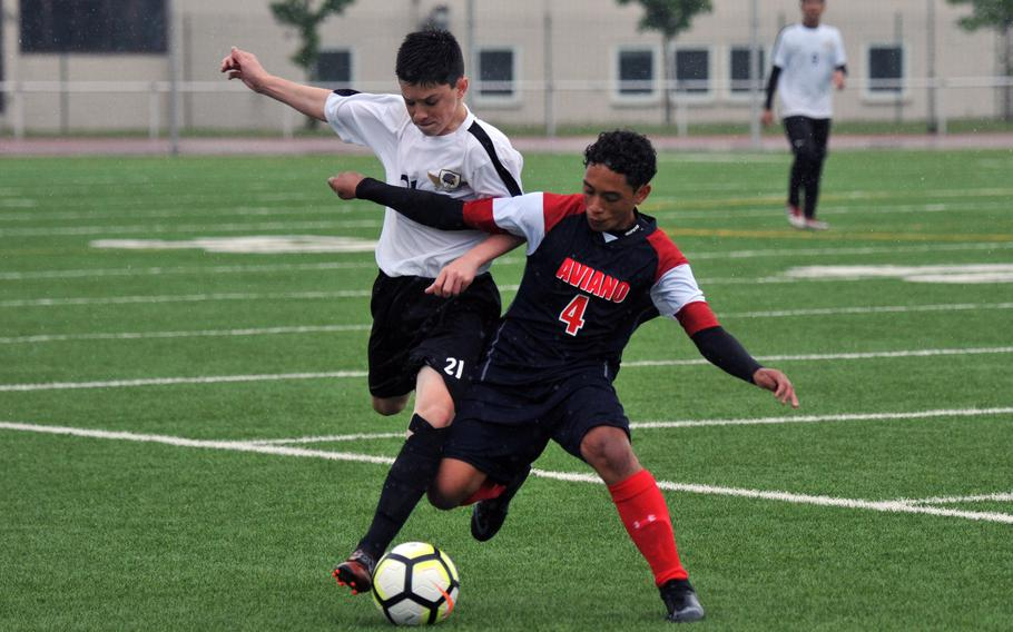 Bahrain's Caleb Wells, left, and Aviano's Nicholas Gilbert fight for the ball in a Division II game in Kaiserslautern, Tuesday, May 21, 2019. The game ended in a 1-1 tie.