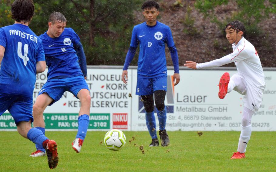 Kaiserslautern's Jalen Tate gets off a shot against Ramstein's Jacob Szczygiel, Benjamin Brewster and Tamar Holmes, from left, in a Division I game in Reichenbach, won by the Royals 4-0.