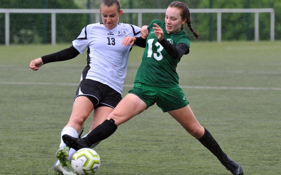 Ramstein's Katherine Ruffing, left, and Naples' Ryleigh Bower fight for a ball in a Division I game at Reichenbach, Tuesday, May 21, 2019. Naples won the game 2-0.