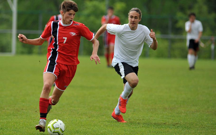 AOSR's Luca Baldestein takes the ball upfield followed by AFNORTH's Hans-Andres Haller in a Division II semifinal in Reichenbach, Wednesday, May 22, 2019. AOSR won the game 1-0 to advance to Thursday's final against Aviano.