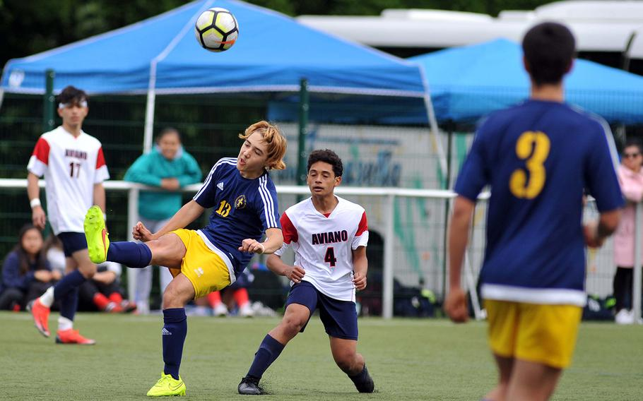 Florence's Edoardo Cariati clears the ball in front of Aviano's Nicholas Gilbert in a Division II semifinal in Reichenbach, Wednesday, May 22, 2019. Aviano won the game 1-0 and will face AOSR in Thursday's final.