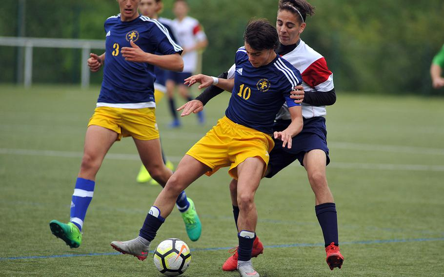 Florence's Carlo Marchi and Aviano's Cole Hinchcliff fight for the ball in a Division II semifinal in Reichenbach, Wednesday, May 22, 2019. Aviano won the game 1-0 and will face AOSR in Thursday's final.