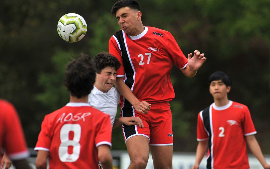 AOSR's Giuseppe Amara gets the header against AFNORTH's Preston Guza in a Division II semifinal in Reichenbach, Wednesday, May 22, 2019. AOSR won the game 1-0 to advance to Thursday's final against Aviano. AOSR's Guglielmo Fradusco, left, and Seung Hyun Na watch the action.