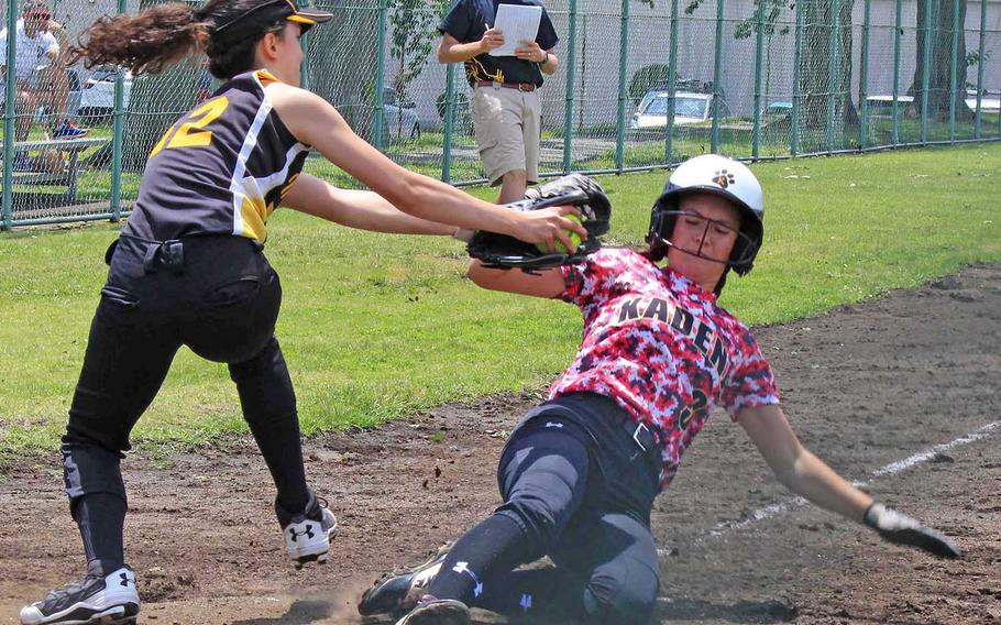 Kadena's Keely Albrecht tries to slide past the tag of American School In Japan's Sasha Sasanuma. Albrecht got the win and the Panthers edged the Mustangs 10-9 during Wednesday round-robin play in the Far East Division I Softball Tournament.