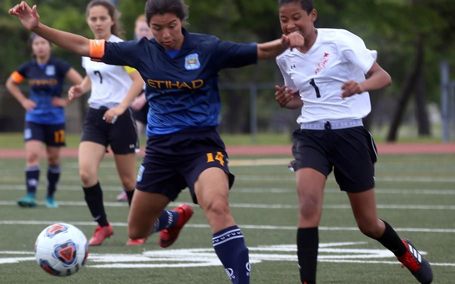 Osan's Maja Inthavixay plays the ball against E.J. King's Jae Garland during Wednesday's Far East Division II girls soccer tournament pool play. The Cougars won 4-1.