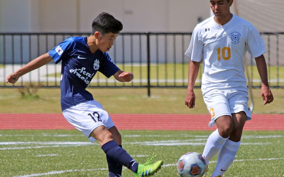 Seoul American' s Tony Oh kicks the ball past Yokota's Marc Delatorre during Wednesday's Far East Boys Division II soccer tournament pool play. The Panthers won 2-0.