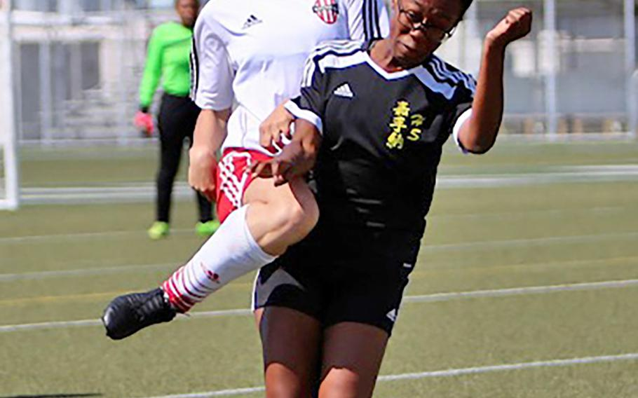 Nile C. Kinnick's Samantha Kenney heads the ball against Kadena's Nyla White during Wednesday's Far East Girls Division I soccer tournament round robin. The Panthers won 2-1, handing the Red Devils their first loss of the season.