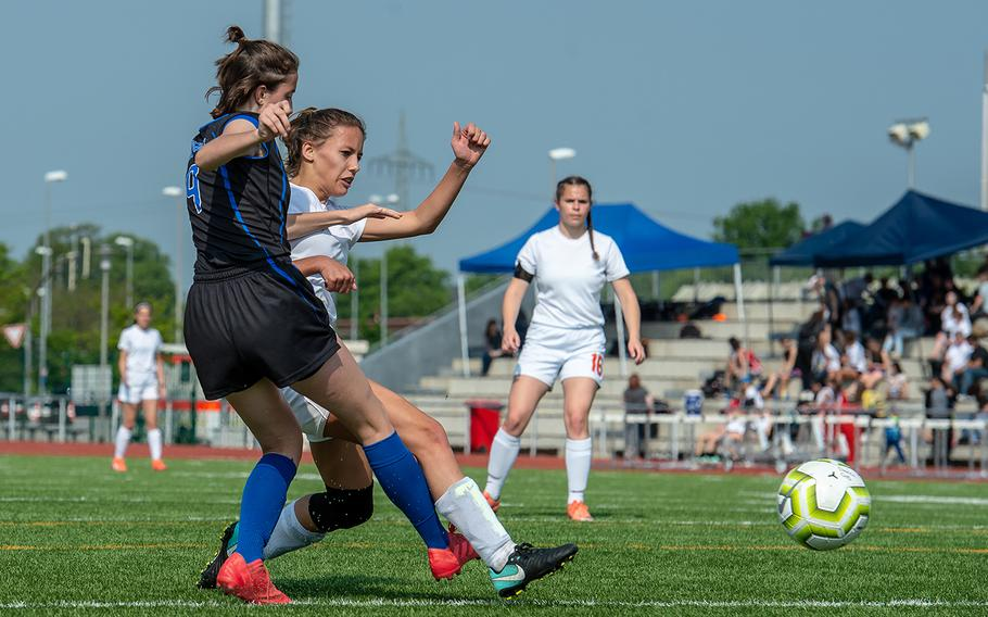 Spangdahlem's Kodee Teahon shoots and scores during a game against Hohenfels in the girls Division III DODEA-Europe soccer championship game, Thursday, May 23, 2019. Spangdahlem won the game 4-2.