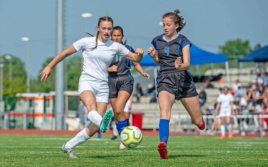 Spangdahlem's Chloe Smith and Hohenfels' Marycate Jackson battle for control of the ball during the girls Division III DODEA-Europe soccer championship game, Thursday, May 23, 2019. Spangdahlem won the game 4-2.