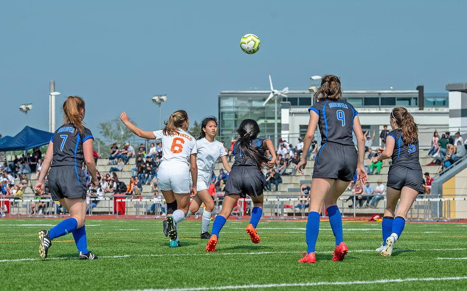 Players from Hohenfels and Spangdahlem go for the ball during the girls Division III DODEA-Europe soccer championship game, Thursday, May 23, 2019. Spangdahlem won the game 4-2.