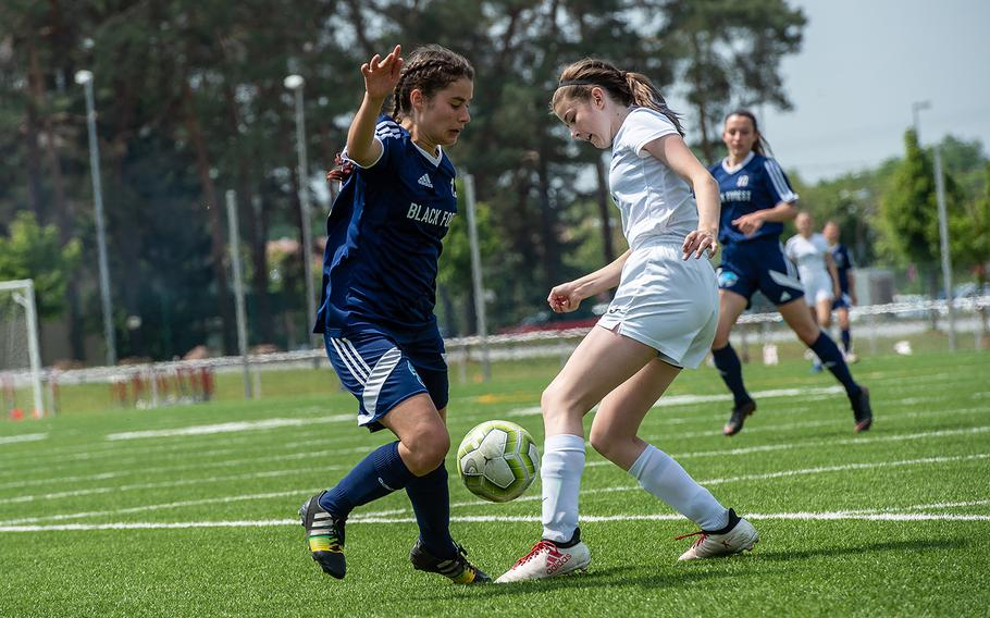 BFA's Debbie Widmer and Marymount's Grace Hitchman battle for the ball during the girls Division II DODEA-Europe soccer championship game, Thursday, May 23, 2019. BFA won the game 5-0.