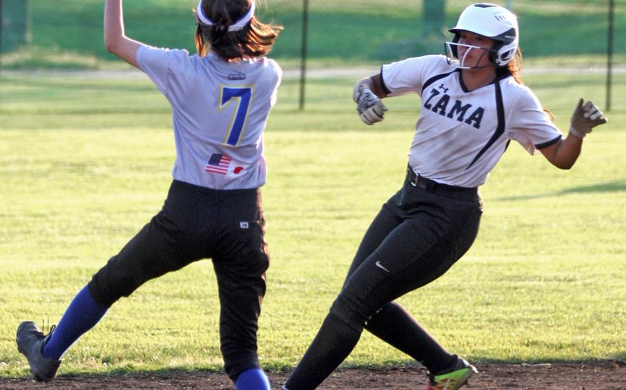 Yokota shortstop Elena Haas fields the ball as Zama's Litzie Figueroa arrives at second base during Thursday's playoff game in the Far East Division II softball tournament. The Panthers won 14-2.