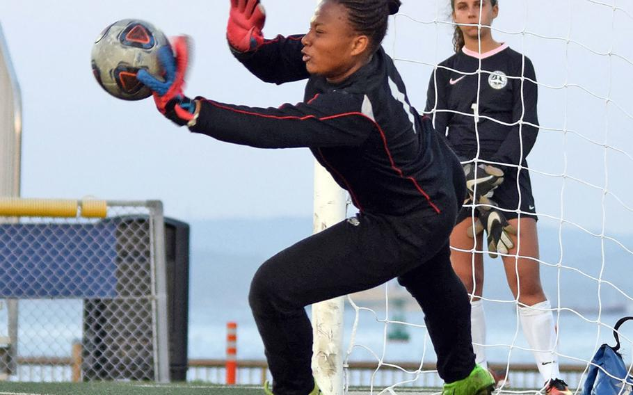 Nile C. Kinnick goalkeeper A'anna Taylor stops an American School In Japan shot during the penalty-kick shootout in Thursday's semifinal match in the Far East Division I girls soccer tournament. The Red Devils dethroned the Mustangs by outshooting ASIJ 3-1 in PKs.