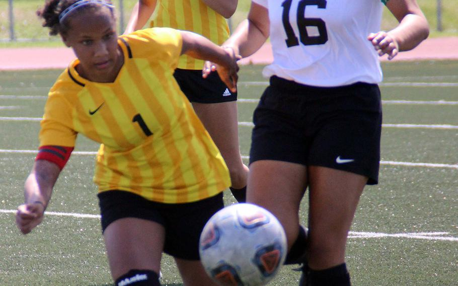 Edgren's Taina Marsh and Daegu's Natalie Garrido battle for the ball during Thursday's round robin in the Far East Division II girls soccer tournament. The Eagles won 2-0.