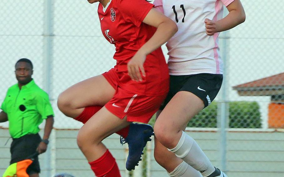 Kinnick's Irie O'Donnell and ASIJ's Shuly Zuo try to settle the ball during Thursday's semifinal in the Far East Division I girls soccer tournament. The Red Devils won in penalties 3-1.