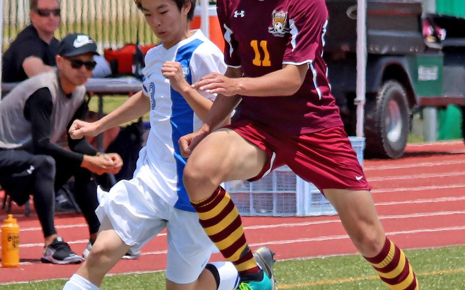 Christian Academy Japan's Hikaru Hayano and Matthew C. Perry's Matthew Torrecillas try to play the ball during Thursday's playoff match in the Far East Division II boys soccer tournament. The Knights won 3-2.
