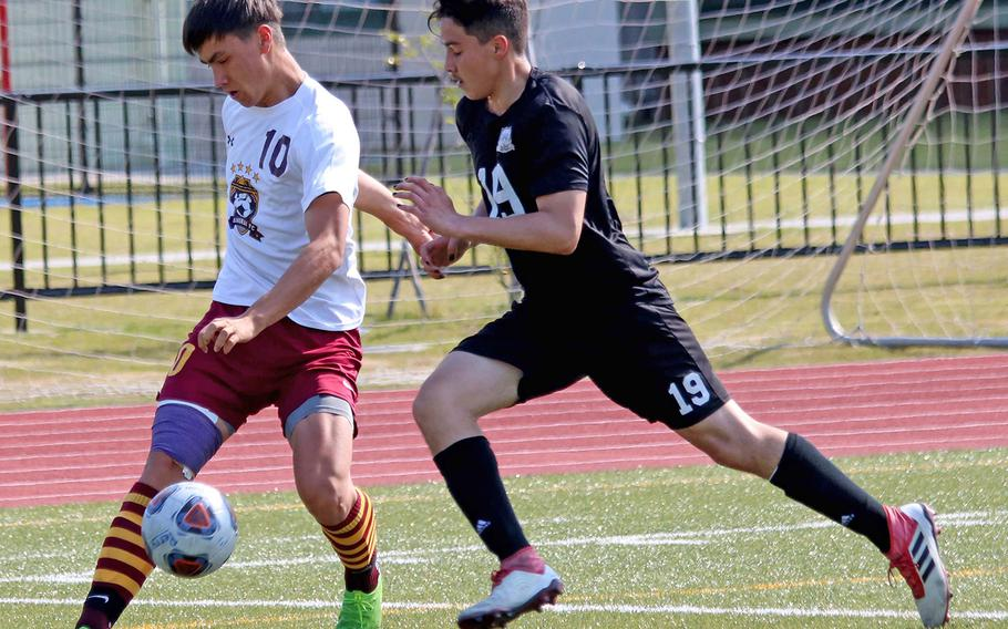 Matthew C. Perry's Kai Lange and Daegu's Kekai Chun-Andrade chase the ball during Thursday's play-in match in the Far East Division II boys soccer tournament. The Samurai won 6-2.