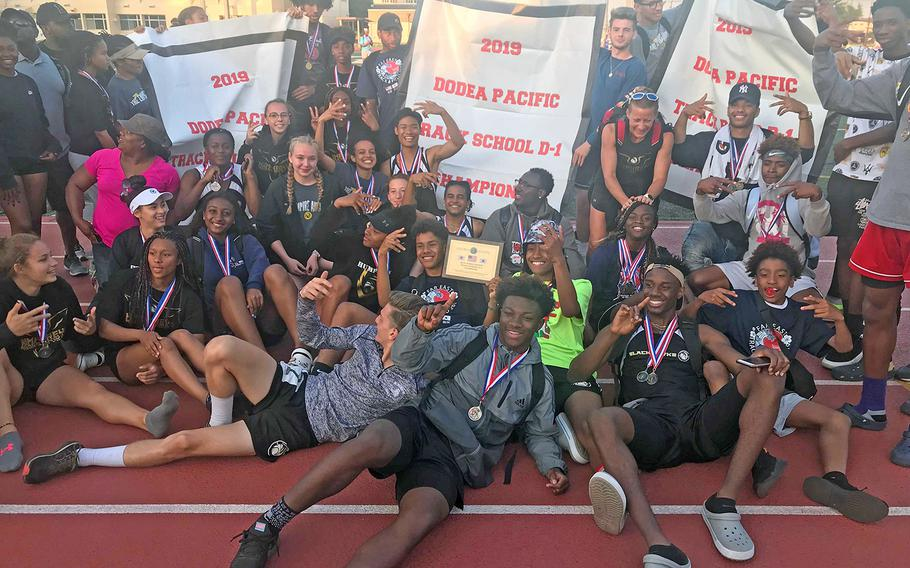 Humphreys shows off its banners following its sweep of the Far East Division I track and field meet titles.