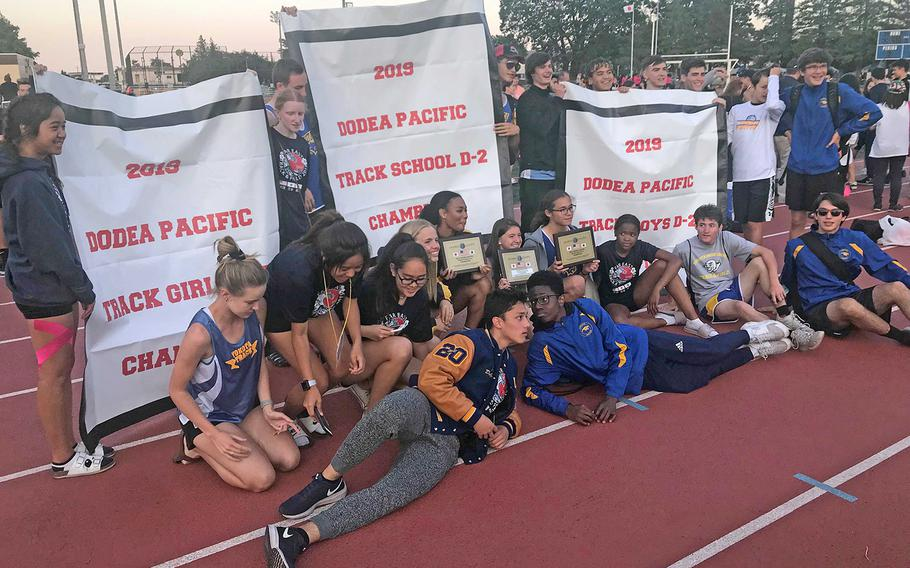 Yokota shows off its banners following its sweep of the Far East Division II track and field meet titles.