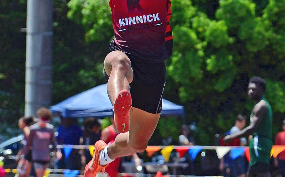 Kinnick's Chris Watson takes off for a Far East track and field meet winning long jump of 6.50 meters.