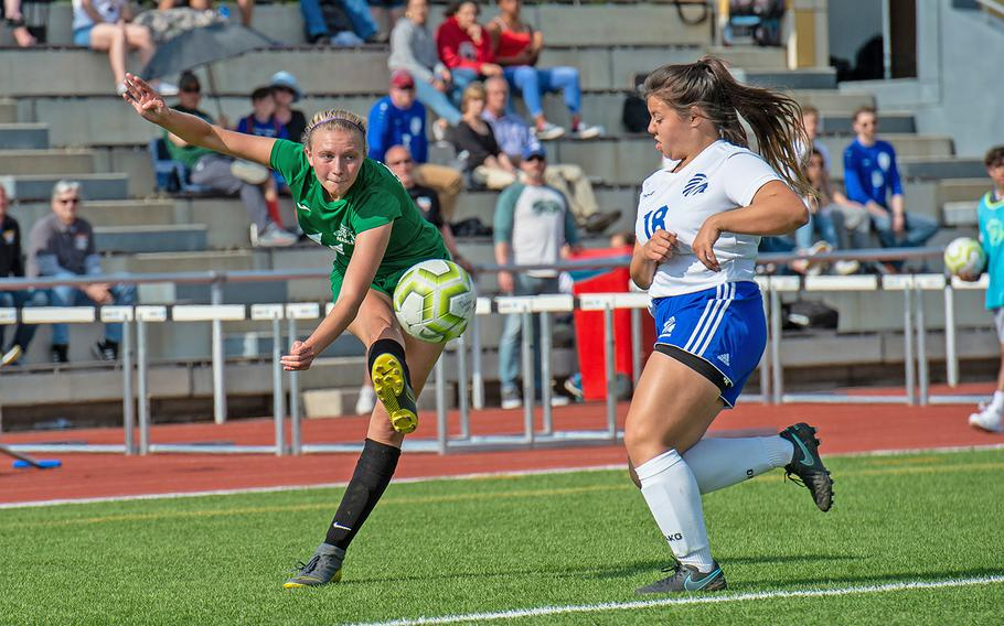 Naples' Victoria Sasse takes a shot on goal during the girls Division I DODEA-Europe soccer championship game against Wiesbaden, Thursday, May 23, 2019. Wiesbaden won the game 2-0.