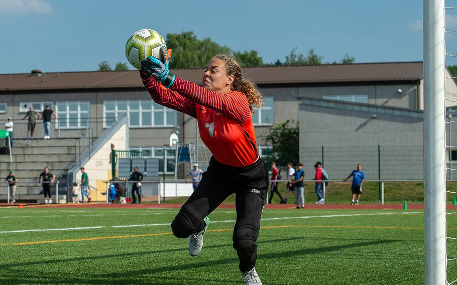 Wiesbaden's goalie Karli Wallace stops a shot during the girls Division I DODEA-Europe soccer championship game against Naples, Thursday, May 23, 2019. Wiesbaden won the game 2-0.